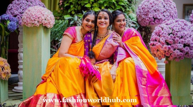 Ashwini dutt daughters in Yellow Kanjeevaram saree.