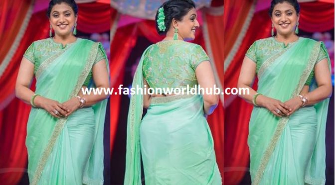 Pastel green saree with designer blouse