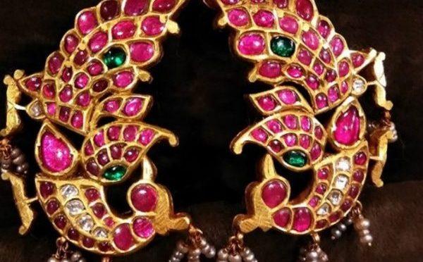 Gold – Ear covered Peacock ear rings.