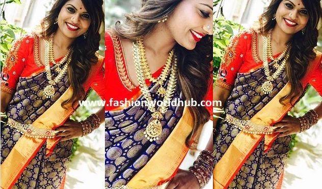 Anchor kathi karthika in Blue and Red Kanjeevaram saree