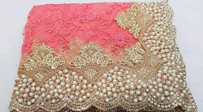 Soft net pearl and stone work designer saree