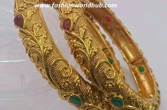 Ruby and emerald gold bangle
