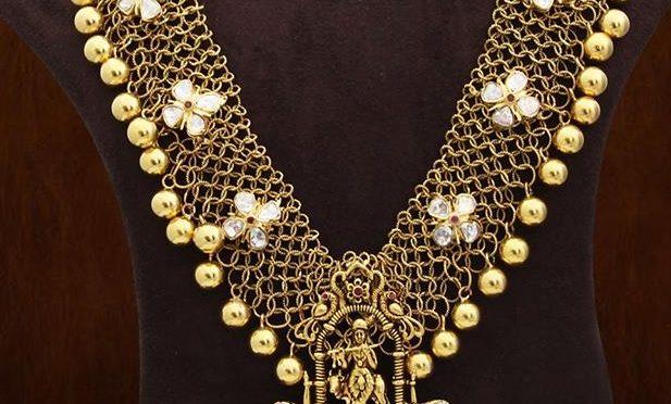 Gold Mesh haram with lord krishna pendant