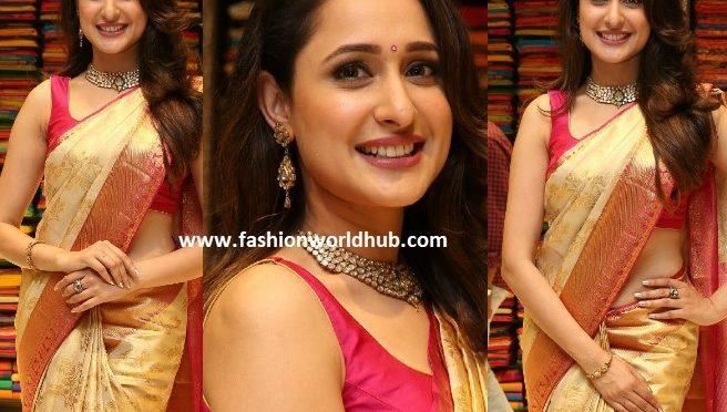 Pragya Jaiswal in a gold Kanchipattu saree at VRK Silks launch