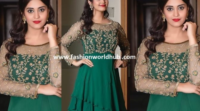 Surabhi in Green Embroidery work gown.