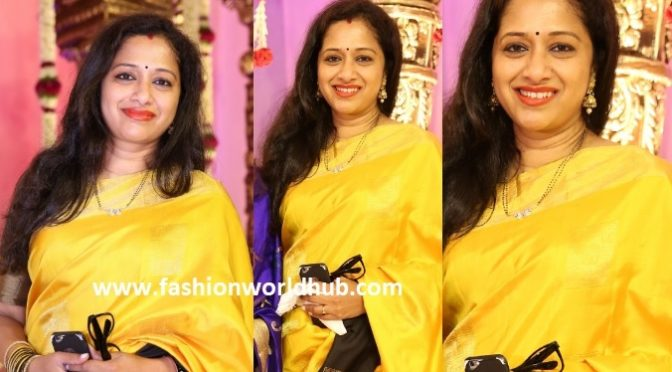 Anitha Chowdary in Yellow saree at a Wedding reception!