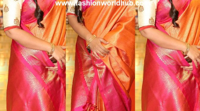 Actress Sneha in Orange and pink Pattu saree!