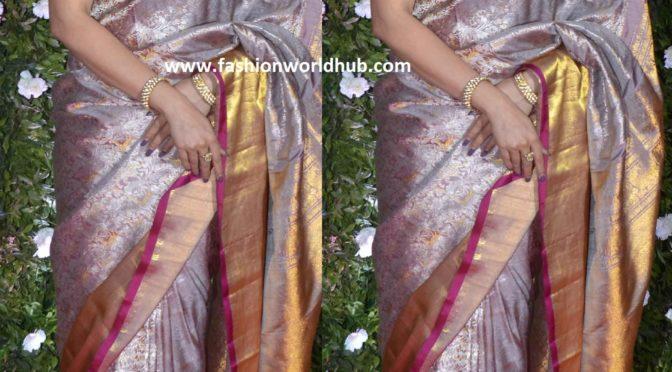 Urmila in a grey Kanjeevaram saree