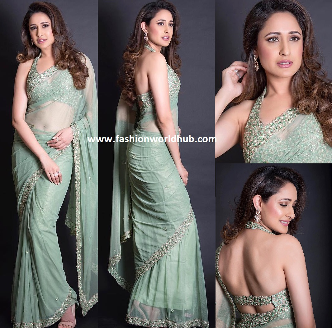 2eac4d39b09694 ... saree paired with embellished halter neck blouse by PLEATS by Kaksha    Dimple. Her look was rounded out with Diamond earrings from Mahesh  Notandass