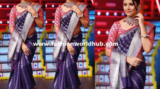 Anasuya in a purple silk Saree