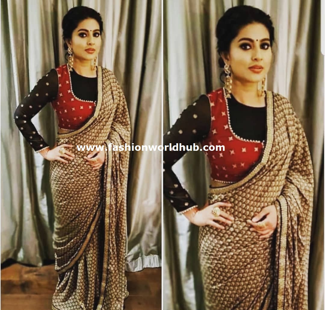 """db5186ab76 ... designer saree paired with full sleeve high neck blouse by """" Geetu  designs"""" . She finished her look statement ear rings, updo hair , red  bindee and ..."""