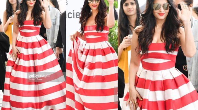 Aishwarya Rai Bachchan in a striped red and white gown!
