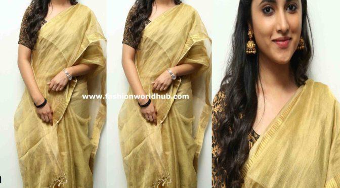 Priyanka Arul Mohan in a gold tissue saree