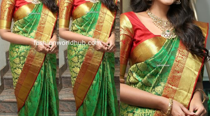 Anupama parameswaran in a Green silk saree