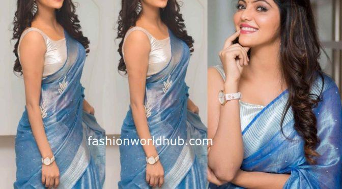 Athulya Ravi in a blue tissue linen saree