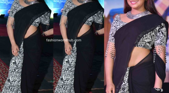 Haripriya in a black and white saree