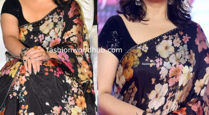 Charmi kaur in a black floral saree at Meeku maathrame chepta pre release event!