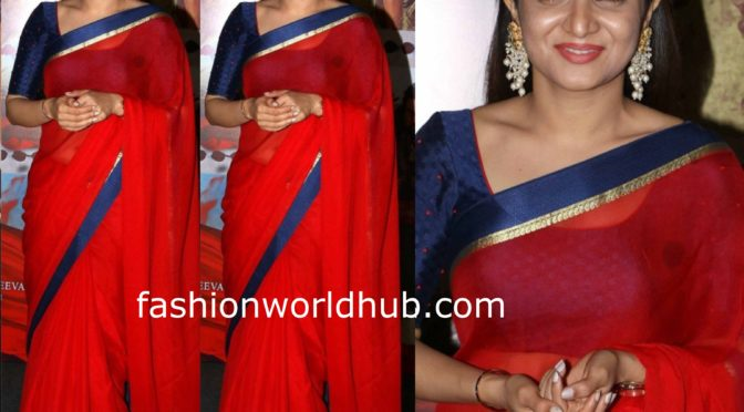 Dhivyadharshini in a red saree at Press meet of Sye Raa Narasimha Reddy