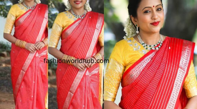 Suma in a traditional saree