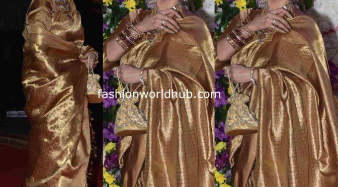 Rekha in a gold Kanjeevaram silk saree