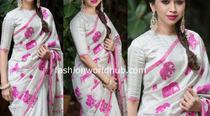 Aarti Ravi in a white silk saree