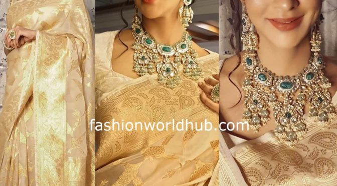 Lakshmi Manchu in a banarasi saree at a wedding