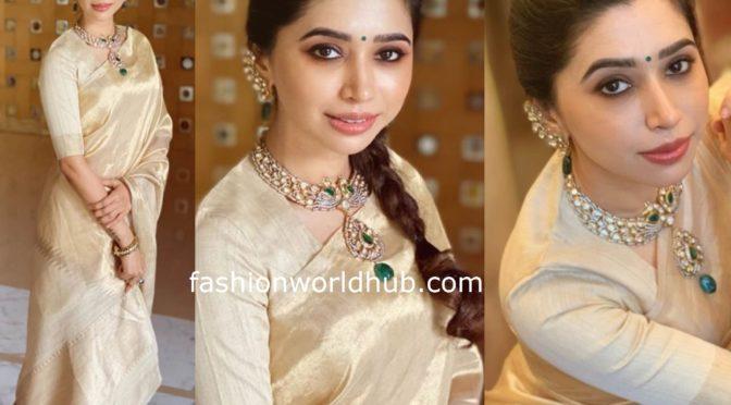 Aarti Ravi  in a Gold Tissue saree!