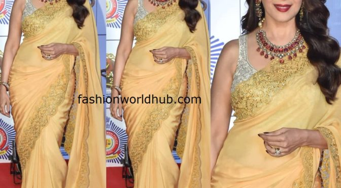 Madhuri Dixit in a yellow saree at the Umang 2020