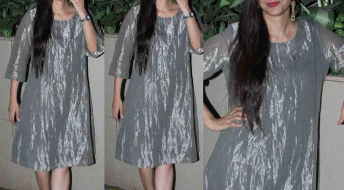 Tabu in silver tissue dress!