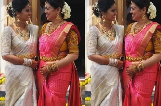 Sneha and her sister geetha in a traditional saree!