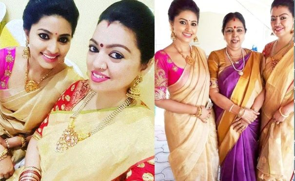 Sneha and her sister in a Gold tissue saree!