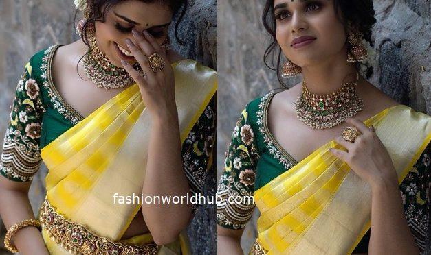Meenakshi Govindharajan in a Traditional yellow silk saree!