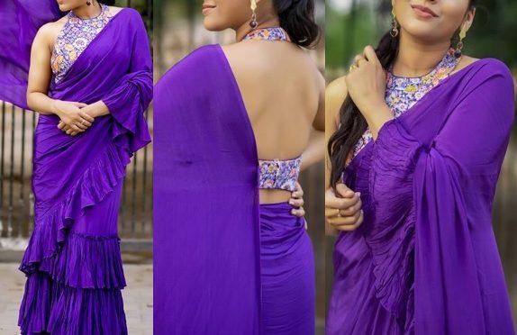 Rashmi Gautam in a purple ruffle saree