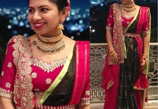 Neeraja Kona in a black kanjeevaram saree at Nithin and Shalini's wedding