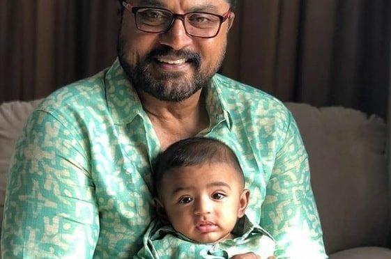 Sarath kumar and his grand son twinning in green!