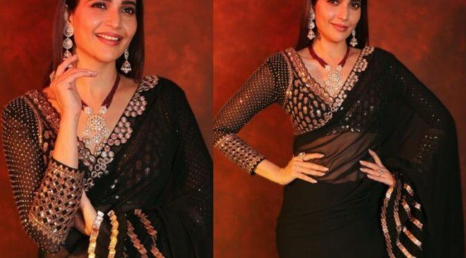 Karishma Tanna stunning in a black saree by Vvani!
