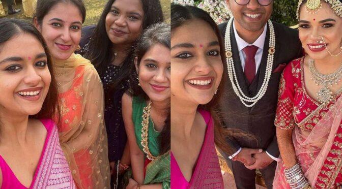 Keerthy Suresh attends her friend wedding wearing a pink kanjeevaram Saree!