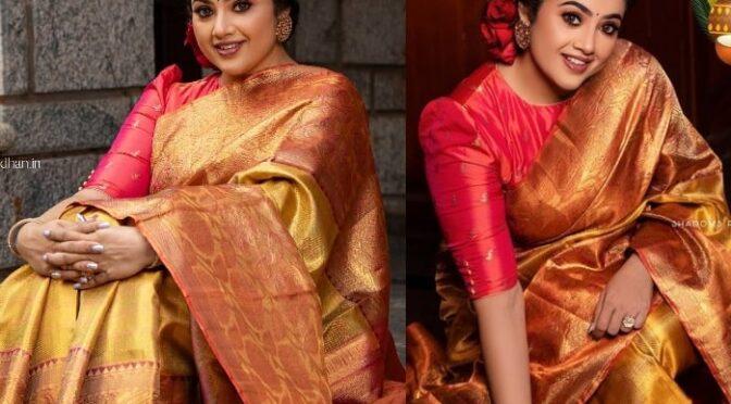 Actress Mena stuns in traditional gold silk saree!
