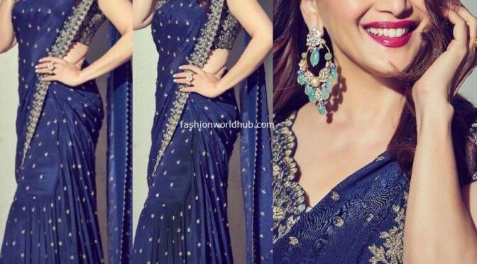 Madhuri Dixit  in Arpita Mehta's royal blue tiered ruffle saree!