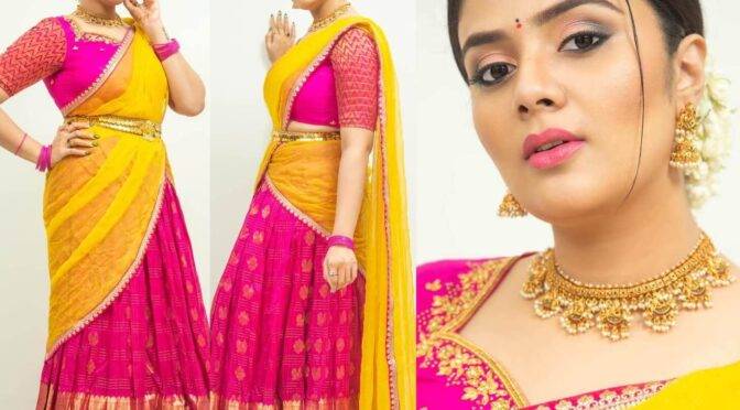 Sreemukhi looking beautiful in traditional halfsaree by Feathers Boutique!