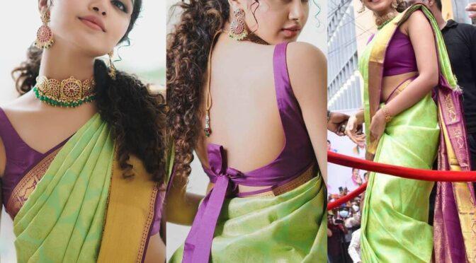 Anupama Parameshwaran looking pretty in green pattu saree for a shop opening!